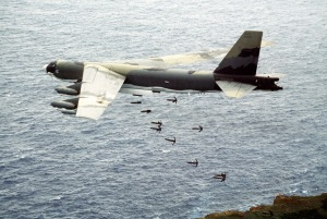 Aircraft dropping Mark 82 227 kg high-drag bombs over Farallon de Medinilla Island, Marianas Islands, during exercise.